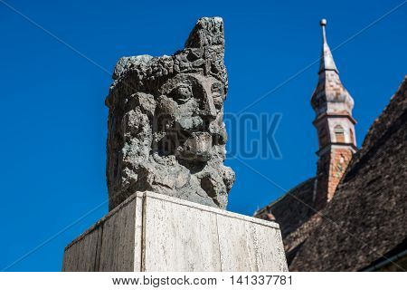 Vlad the Impaler statue next to Monastery Church in Sighisoara town in Romania