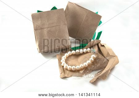 brown pearl in paper bag on white background