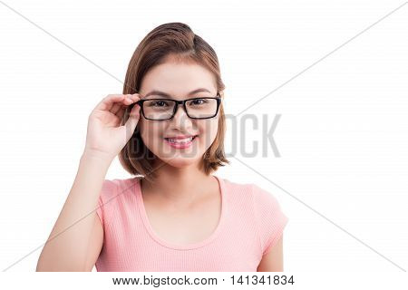 Closeup portrait of a young cheerful asian woman in glasses