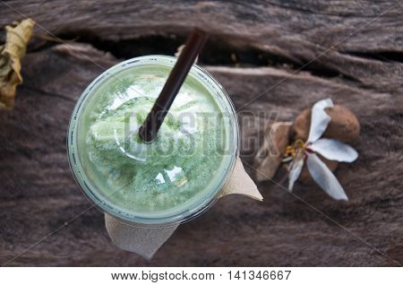 green tea frappe in nature background, top view