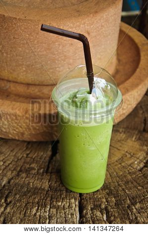 Green Tea Frappe in cup on wood table