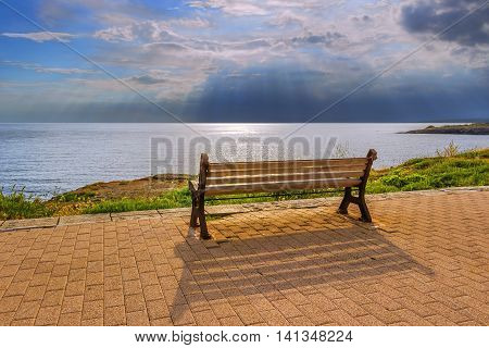 Colors of Apulia: The color of the time. Santa Maria di Leuca (Lecce).- ITALY (Salento)-Empty bench between sky and sea.