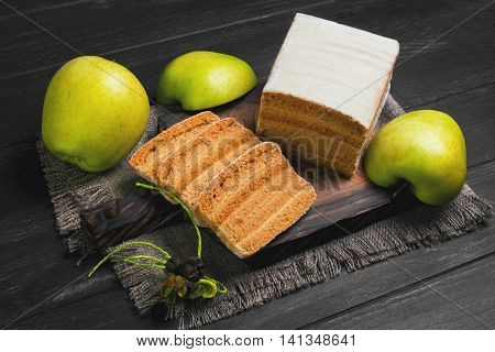 Apple biscuit Pie fresh apples sacking on cutting board black wooden background surface