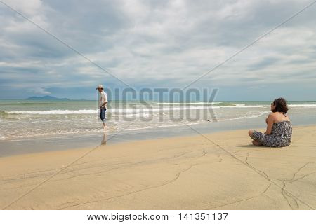 Man And Woman Looking Into Sea Of China Beach Danang