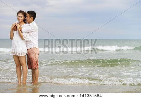Young Couple Embracing Each Other At China Beach In Danang