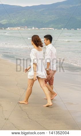 Young Couple Walking At The China Beach In Danang Vietnam