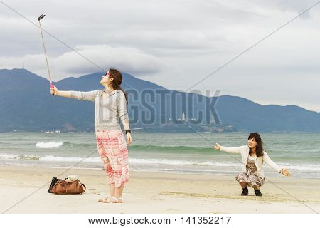 Young Girls Making Selfie At China Beach Danang