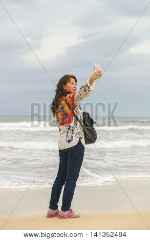 Young Woman Making Selfie In China Beach Danang