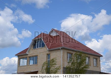 House With A Roof Made Of Metal Sheets