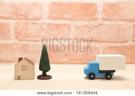 Toy car trucks on wood. logistics, distribution, and delivery concept.