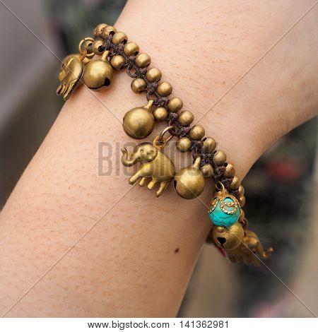 Elephant brass bracelet handmade on her hand