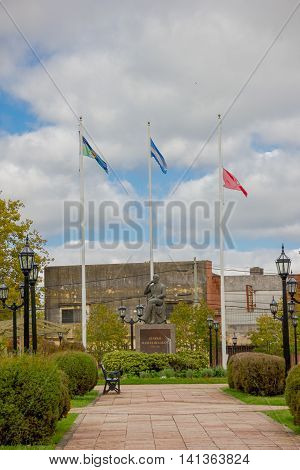 TIGRE, ARGENTINA - MAY 02, 2016: the statue of Manuel Belgrano with argentina's flag behind in one park of the city