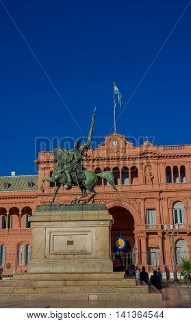 BUENOS AIRES, ARGENTINA - MAY 02, 2016: statue of the general Manuel Belgrano infront of the pink house, located in plaza de mayo.