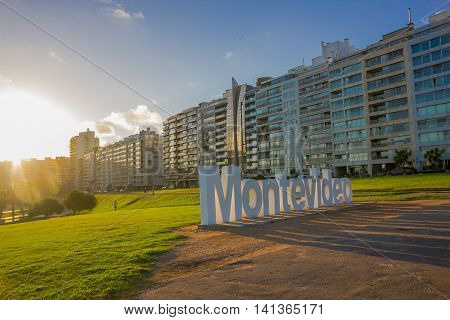 MONTEVIDEO, URUGUAY - MAY 04, 2016: nice view of the city buildings located infront of a park where the montevideo sign is.