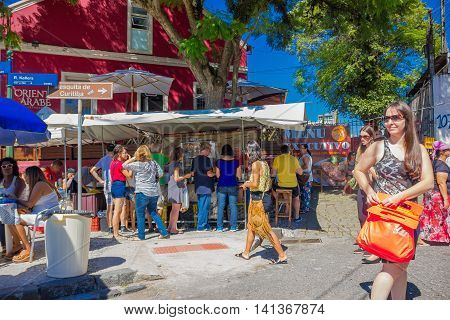 CURITIBA , BRAZIL - MAY 12, 2016: unidentified people buying some food at a little stand located in a corner close to the city market.