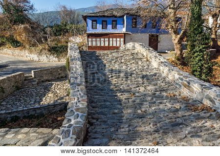 Stone bridge over small river in Moushteni near Kavala, East Macedonia and Thrace, Greece poster