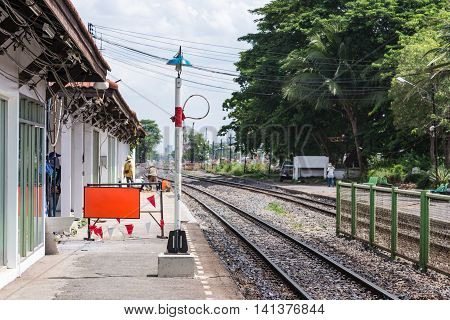 Safety loop on the signal pole for train driver take it before leaving the stationThailand.