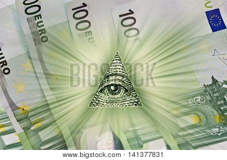 Dollar USA. European 100 Euro. Element of the image of United States one-dollar bill pyramid Eye of Providence Beams from pyramid every which way over banknotes hundred euros. Conceptual photo for successful business design. Macro.