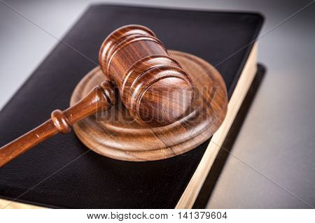 Courtroom Gavel On Top Of A Book