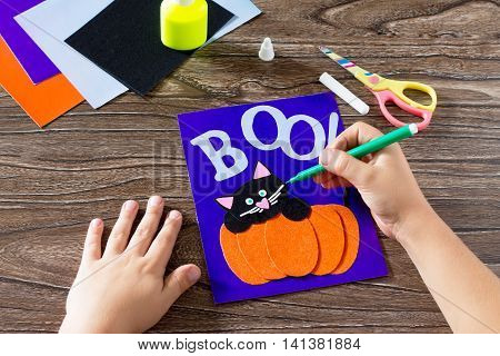 The Child Create A Greeting Card Halloween Paper Black Cat In Pumpkin, Paints, Paper Parts. Glue, Sc