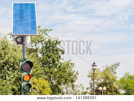 Road traffic light powered by electricity generated from a solar panel