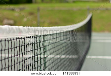 Selective focus on a tennis net. Shallow depth of field is intentional.
