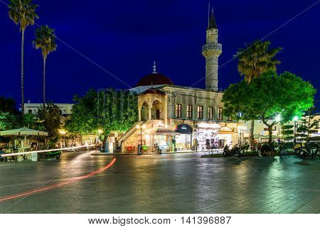 Kos island, Greece - May 12, 2016: Eleftherias square is the main square of Kos at night in May 12, 2016, Kos island, Dodecanese, Greece.