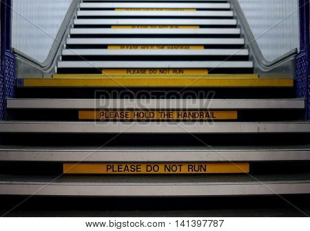 train station stairs caution sign slough yellow