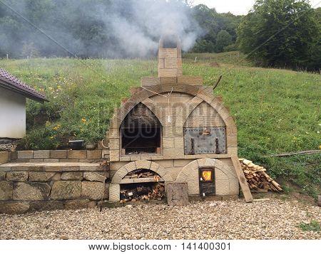 Romania, August 20, 2015, Gura-Teghii,Buzau County, Moldova,  Bed&breakfast in the mountains-exterior bread oven