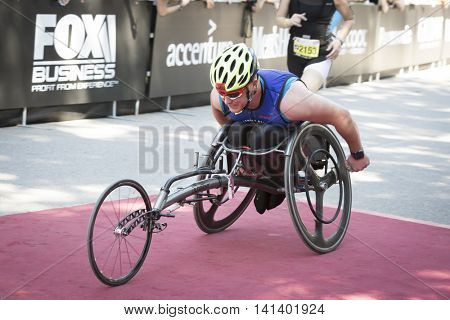 NEW YORK JUL 24 2016: ParaTriathlete from CAF, Challenged Athletes Foundation, crosses the finish line in Central Park in the NYC Triathlon Race, the only International Distance triathlon in the city.