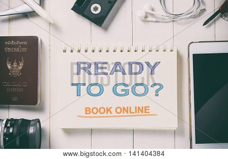Ready to go book online now, Travel agency banner. traveller equipment background with advertising text.