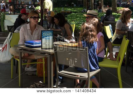 New York NY USA -- Aug 3 2016 New Yorkers playing board games in Bryant Park at lunchtime. Editorial Use Only