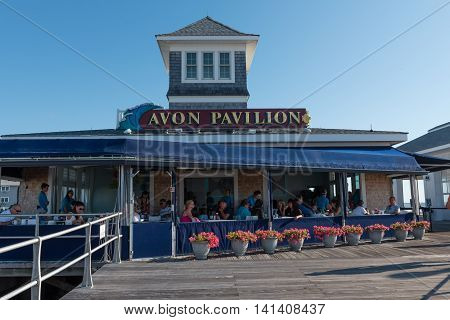 Avon-by-th-Sea NJ USA -- Aug 4 2016 People enjoying breakfast outdoors at a boardwalk restaurant on a sunny summer morning. Editorial Use Only