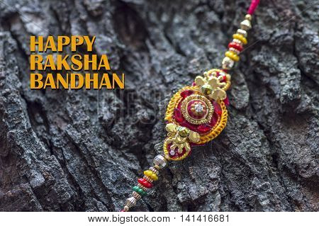 Raakhi - A traditional Indian wrist band which is a symbol of love between Brothers and Sisters. Raksha Bandhan Greeting.