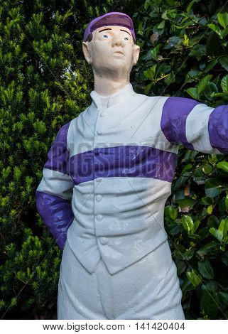 Lexington United States: May 6 2016: A purple and white lawn jockey status memorializes horse racers in Kentucky