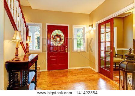 Horse Ranch Entryway With Red Door And Hardwood Floor.