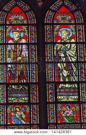 PARIS, FRANCE - MAY 31, 2015 Saints Augustus Bishop Angels Stained Glass Notre Dame Cathedral Paris France. Notre Dame was built between 1163 and 1250 AD.