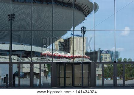 Katowice, Poland - July 10, 2016: The reflection in the glass walls of the Congress Centre in Katowice. The visible part of the hall show