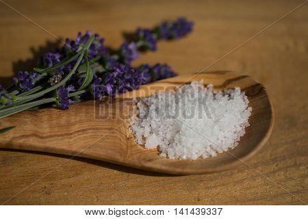 fleur de sel , on a olive wood spoon