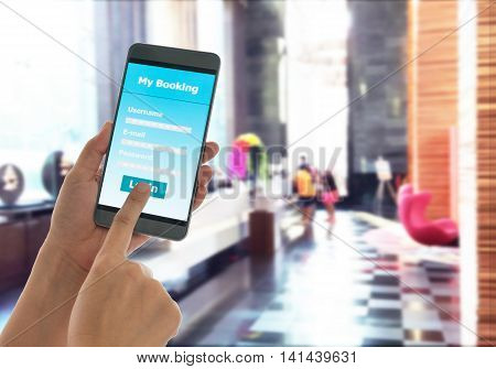 close-up view of holding mobile smart phone Booking hotel.