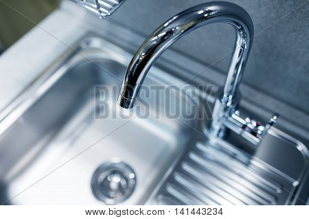 Modern Tap Faucet And Sink On New Kitchen