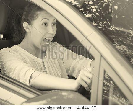 Girl in the red car emergency brake. Road trip risk danger concept