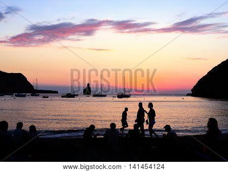 People watching the sunset at Benirras Beach