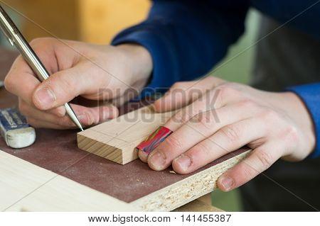 carpenter makes on wooden track mark - closeup