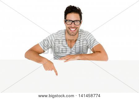 Smiling man pointing to the white board