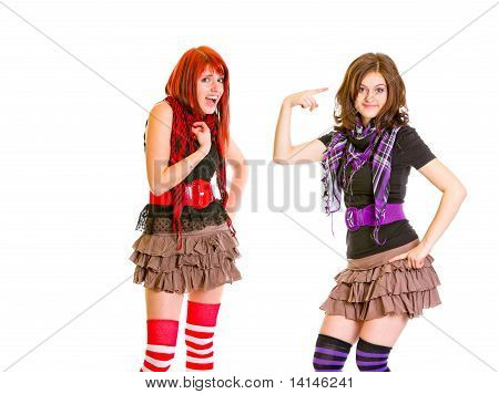 Indignant girl with hand on chest and her girlfriend showing crazy gesture isolated on white