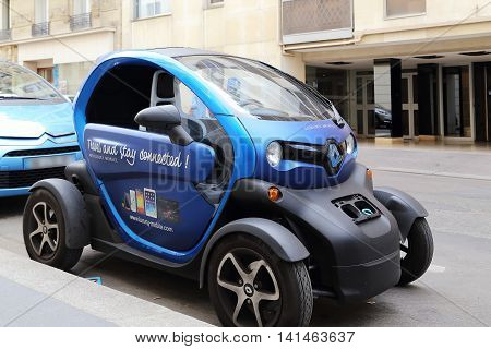 PARIS, FRANCE - MAY 12, 2015: The Renault Twizy is a battery-powered 2 seat electric city car designed and marketed by Renault on a Parisian streets .