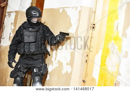 Special forces armed with pistol ready to attack