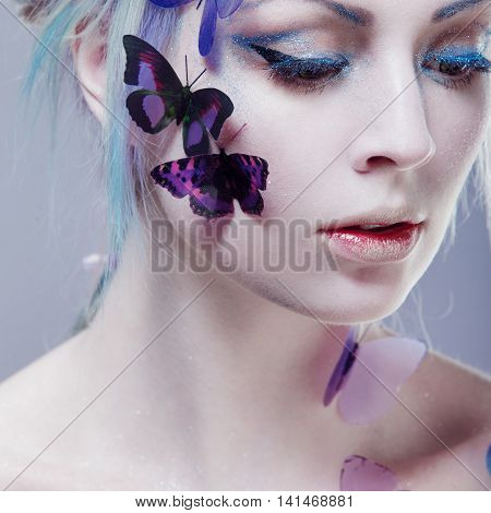 Beautiful Girl With Butterfly. Creative Make up and Hair Style.