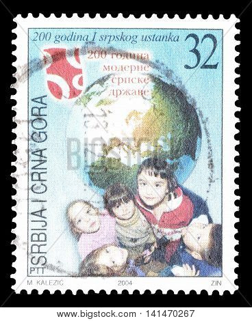 SERBIA AND MONTENEGRO - CIRCA 2004 : Cancelled postage stamp printed by Serbia and Montenegro, that shows Children and Earth.
